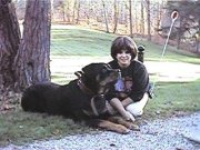 Carol kneeling near